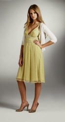 The yellow lemon beade dress �120 from French Connection is Grecian in line and has that same soft feminine charge.  It's teamed with acream cardigan �55 and gold shoes �75.